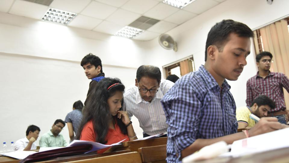 New Delhi, India - July 5, 2016: Students filling up the forms at SRCC. After the second cut off list came out students visited the Delhi University colleges to start their admission procedure in New Delhi, India, on Tuesday, July 5, 2016. (Photo by Saumya Khandelwal/ Hindustan Times)