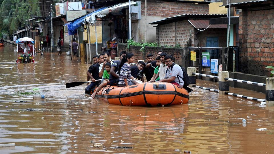 Residents of Anil Nagar and Nabin Nagar being evacuated by State Disaster Respond Force (SDRF) from flood affected areas in Guwahati . The district administration had ordered closure of government and private schools and colleges today. (PTI)