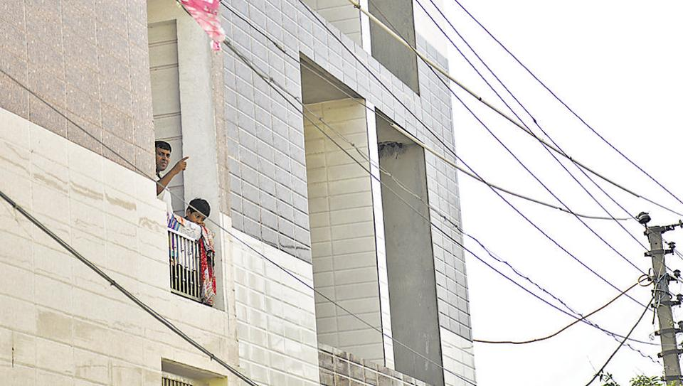 The loose power cables still hang outside the woman's flat in Ghaziabad.