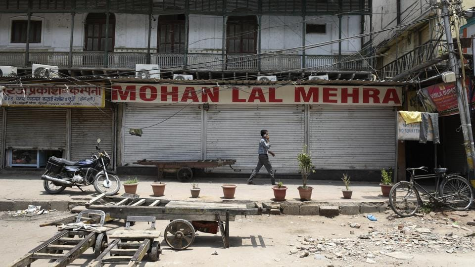 A man walks past a closed shop in Old Delhi after Chandni Chowk Sarv Vyapar Mandal called for a bandh in protest to the new taxation rules viable from next month.  (Saumya Khandelwal/HT PHOTO)