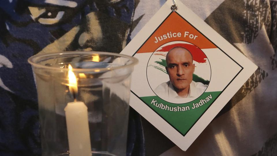 A man holds a candle as he participates in a demonstration in support of Indian naval officer Kulbhushan Jadhav in Mumbai. ICJ had ordered Pakistan not to execute Jadhav convicted of espionage and terrorism.