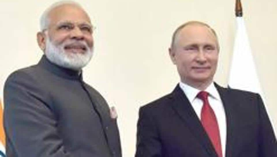 Prime Minister Narendra Modi with Russian President Vladimir Putin at the 18th India Russia Annual Summit, at Konstantin Palace, in St. Petersburg.