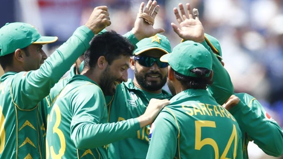 Pakistan cricket team's Junaid Khan celebrates with teammates after getting the wicket of England cricket team's Jos Buttler, caught by Sarfraz Ahmed, during their ICC Champions Trophy semifinal on Thursday.