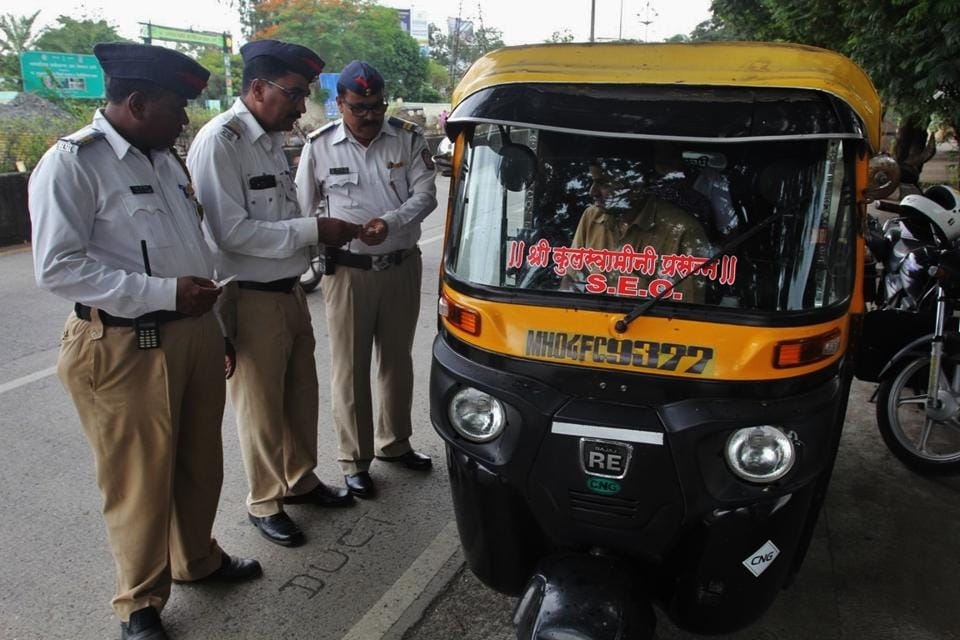 Traffic police personal check an auto driver's documents.