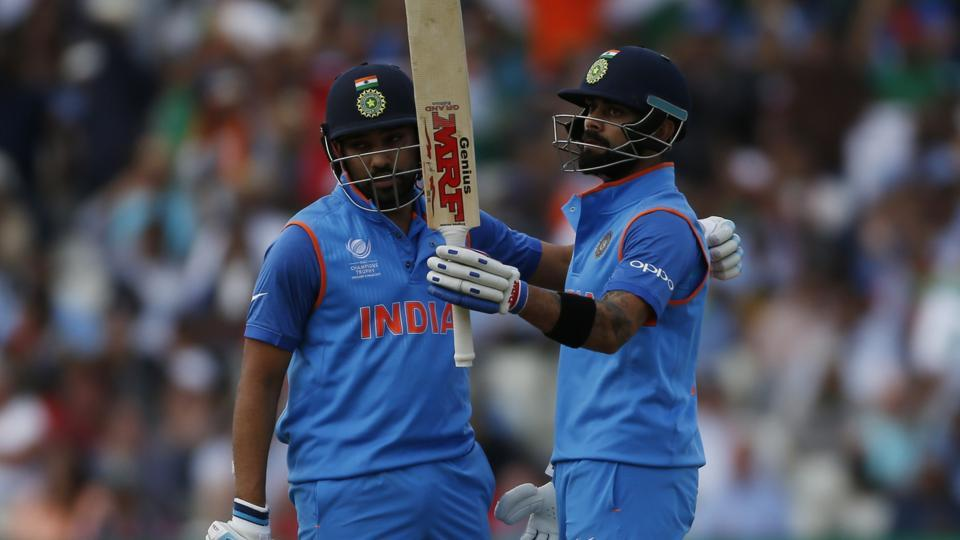India's Rohit Sharma celebrates with captain Virat Kohli during ICC Champions Trophy 2017 semi-final against Bangladesh. Get highlights of India vs Bangladesh here .