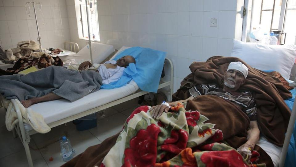 FILE -- In this May. 15, 2017 file photo, people are treated for suspected cholera infection at a hospital in Sanaa, Yemen. The United Nations warned Thursday, June 15, 2017, that the cholera outbreak in Yemen, that has already killed over 900 people, is depleting aid resources to the point they won't be able to provide food to the famine-stricken country through the summer.