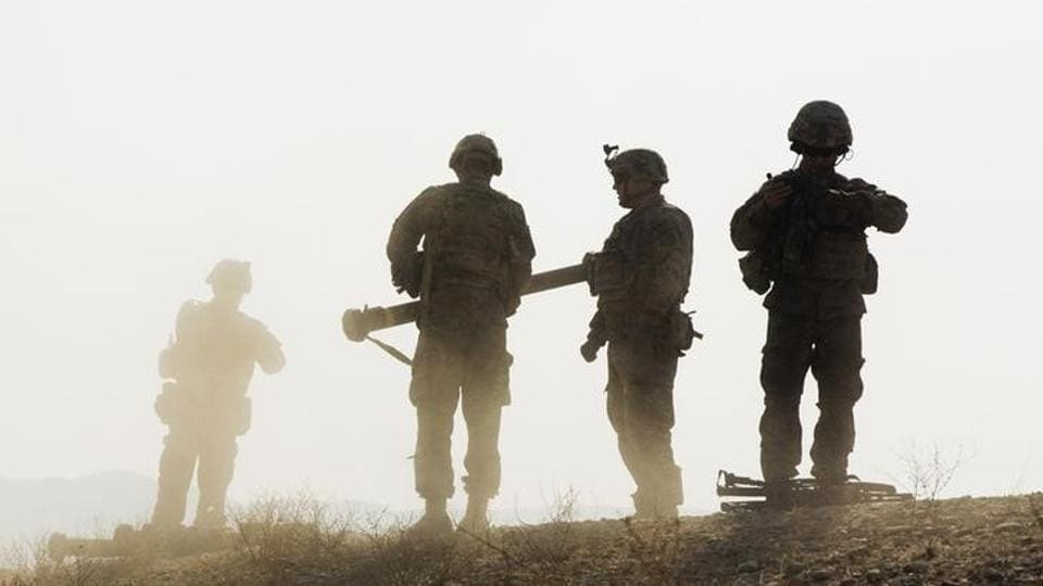 US soldiers from the 3rd Cavalry Regiment walk on a hill after finishing a training exercise near forward operating base Gamberi in Laghman province of Afghanistan in December 2014.