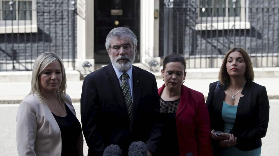 Sinn Fein president Gerry Adams (centre left) and leader of Sinn Fein in Northern Ireland Michelle O'Neill (left) speak to the press after a meeting with British Prime Minister Theresa May at 10 Downing Street in London on June 15, 2017.