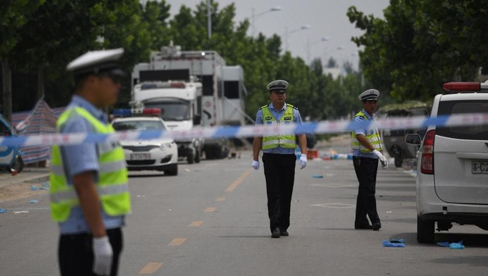 Police officers stand outside a kindergarten where an explosion killed 8 people and injured dozens a day earlier, in Fengxian, in China's eastern Jiangsu province on June 16, 2017. Chinese police said on June 16 the explosion that killed eight people outside a kindergarten was caused by a makeshift bomb and the bomber died in the blast.
