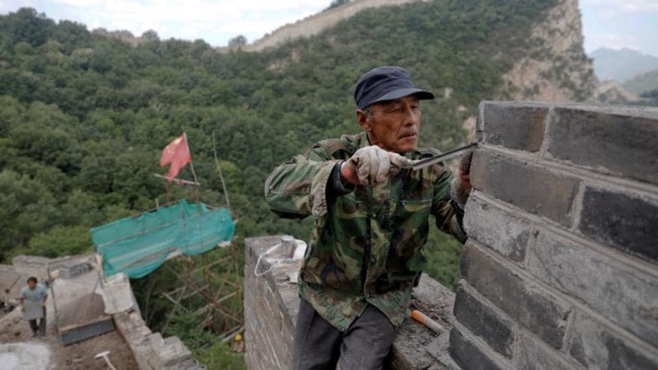 In order to preserve the historical and cultural aspect of the Great Wall, workers have used original bricks that broke off the wall over the centuries or made new bricks that matched the specifications. (Damir Sagolj/REUTERS)