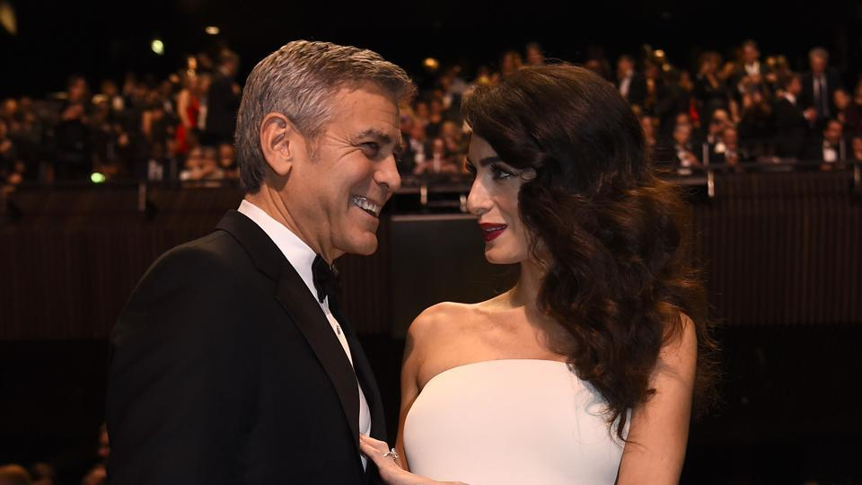 US actor George Clooney and his wife British-Lebanese lawyer Amal Clooney pose as they arrive for the 42nd edition of the Cesar Ceremony at the Salle Pleyel in Paris on February 24, 2017.