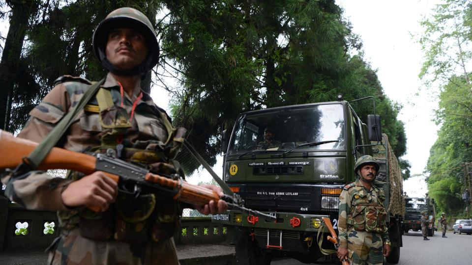 Indian army personnel stand guard during an indefinite strike called by the Gorkha Janmukti Morcha (GJM) in Darjeeling, West Bengal on June 16, 2017. Paramilitary troops and riot police increased patrolling after fresh violence as a result of a raid at GJM party chief Bimal Gurung's office on Thursday. The GJM's call for an indefinite strike stems from demands for a separate state of Gorkhaland and escalated with apprehensions against the imposition of Bengali language in local schools. (Diptendu Dutta/AFP)