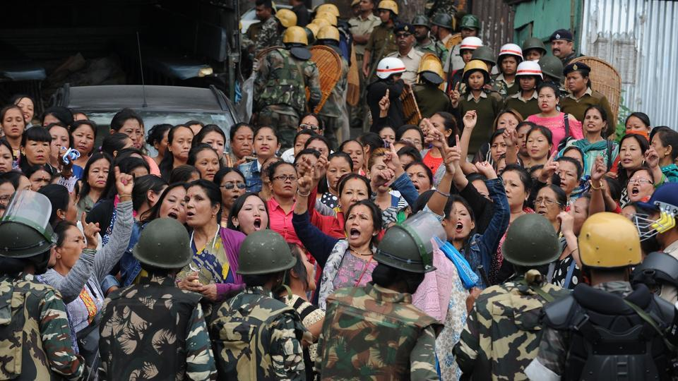 Police personnel stop Gorkha Janmukti Morcha (GJM) supporters following a raid at the GJM office in Darjeeling on June 15, 2017. Incidents of arson against government establishments were reported throughout Thursday. (Diptendu Dutta/AFP)