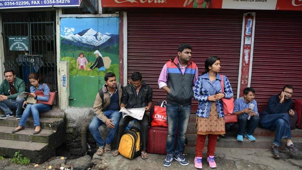 Stranded tourists wait for communication during the indefinite strike called by the Gorkha Janmukti Morcha. Tourists in the hill station have been left stranded with transport hotels and food services affected