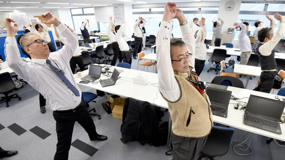 Instructions for the three-minute exercise are also played daily on public broadcaster NHK, with different sets tailored for building strength or for the elderly and disabled.  (TORU YAMANAKA  / AFP)