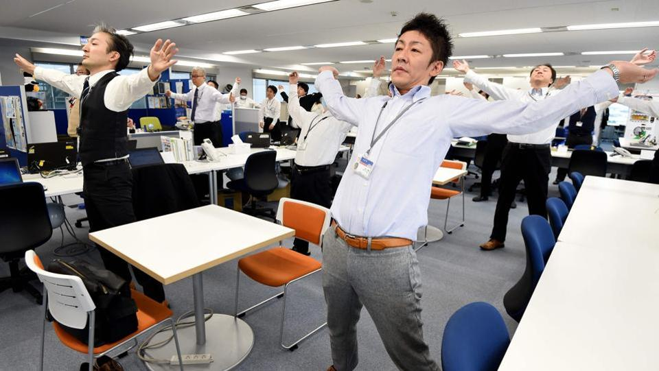Japan's population is quickly getting older and there are fewer and fewer kids — this is very big risk for companies. With almost zero formal immigration, companies need to keep staff fit in the hope they'll work past the usual retirement age. (TORU YAMANAKA  / AFP)
