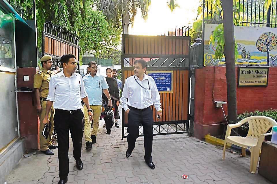 CBI officials leave Manish Sisodia's residence in New Delhi on Friday.