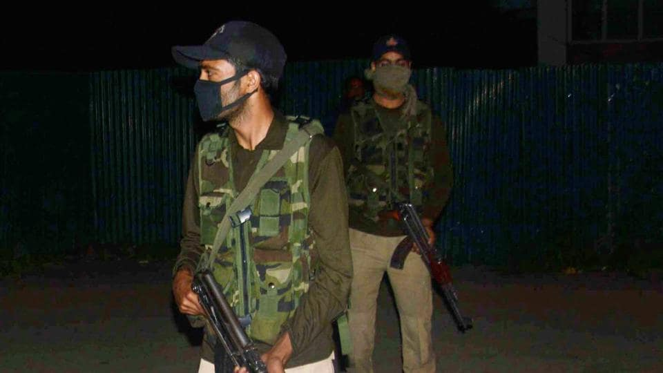 The Special Operations Group of Jammu and Kashmir Police take guard after a militant attack in Anantnag.