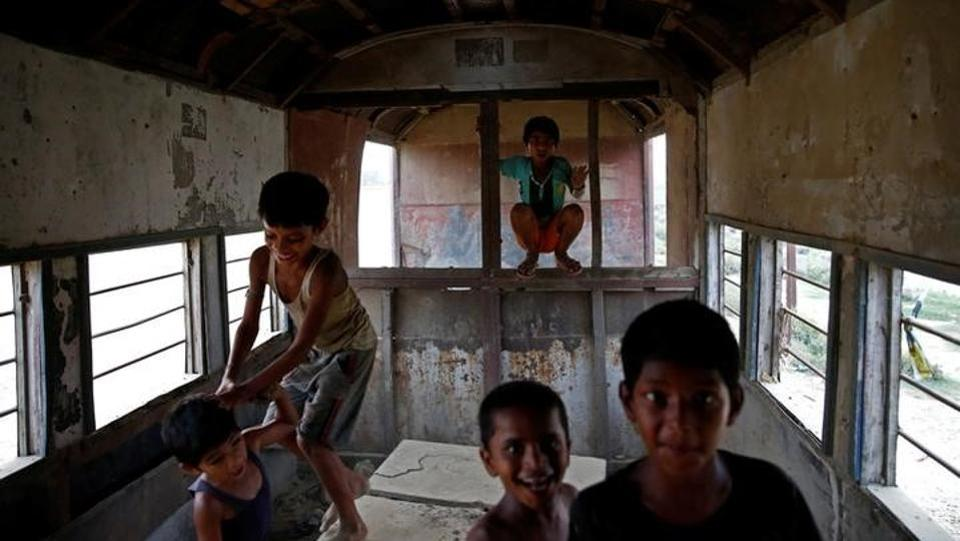 Now the only sign of life is laughing children, who chase each other through the disintegrating carriages, climbing on rusting benches and tumbling over one another. (Navesh Chitrakar / Reuters)