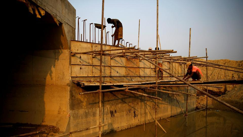 Indian labourers work on part of a bridge for the new railway in Janakpur. The revamp of the railway, set to be completed next March, presents clear signs of renewal and the improvements to come. (Navesh Chitrakar / REUTERS)