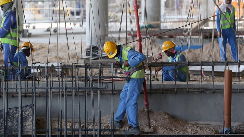 This file photo taken on October 03, 2013 shows migrant labourers working on a construction site on October 3, 2013 in Doha in Qatar. A diplomatic crisis in the Gulf has seen Qatar isolated after regional giant Saudi Arabia and several allied countries cut all ties to Doha. But outside the corridors of power, it is Qatar's foreign workforce - totalling more than two million, mostly from south Asia -- who are on the frontline when it comes to the immediate impact of the crisis.