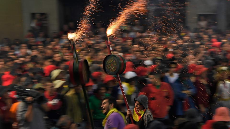 Dragons, giants, dwarfs and mules parade through the streets and main town square of Berga for the annual festival of La Patum, a celebration that has evolved over centuries that essentially celebrates the defiance of a community refusing to change. (LLUIS GENE / AFP)