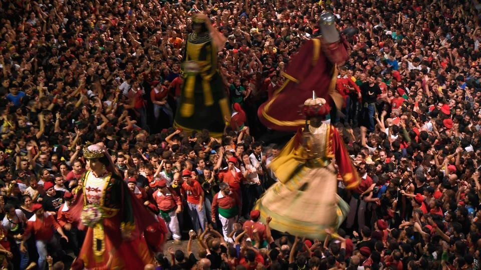The festival's origins date back to the Middle Age processions that marked Corpus Christi, which included theatrical performances and massive effigies being held aloft - and very little was different as thousands gathered in the city on Friday for its famous closing parades. (LLUIS GENE / AFP)