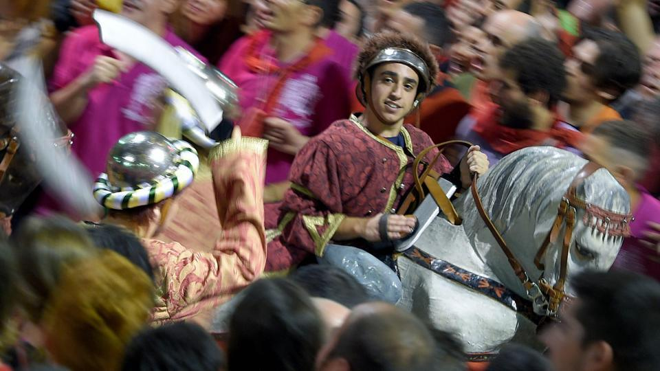 The earliest recorded performances of this kind date back to 1454, has kept the cultural and religious celebration alive in this form. (LLUIS GENE / AFP)