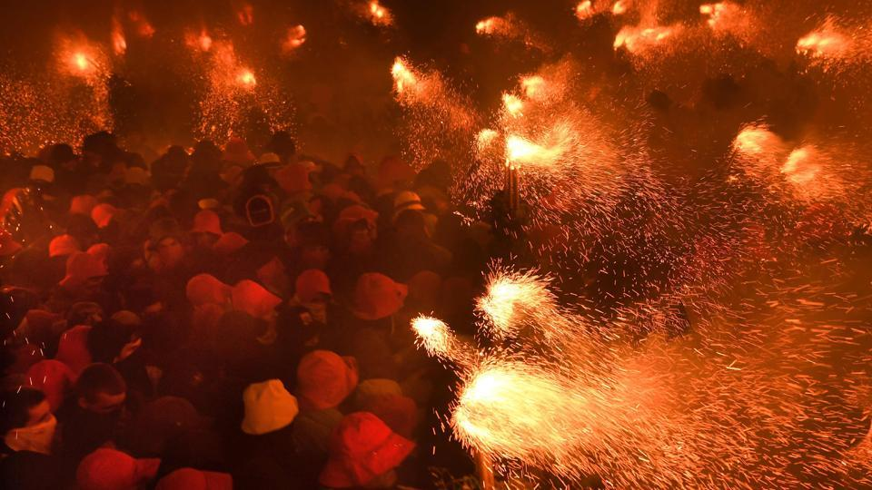 The festival culminates in a parade of effigies representing a range of figures, often shooting flames . (LLUIS GENE / AFP)