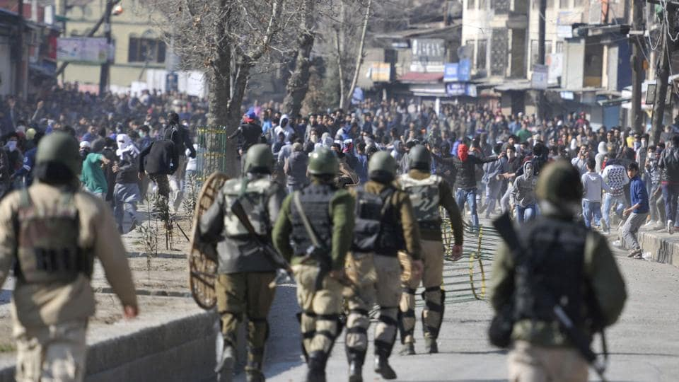Protesters clash with police and paramilitary troopers in Srinagar.