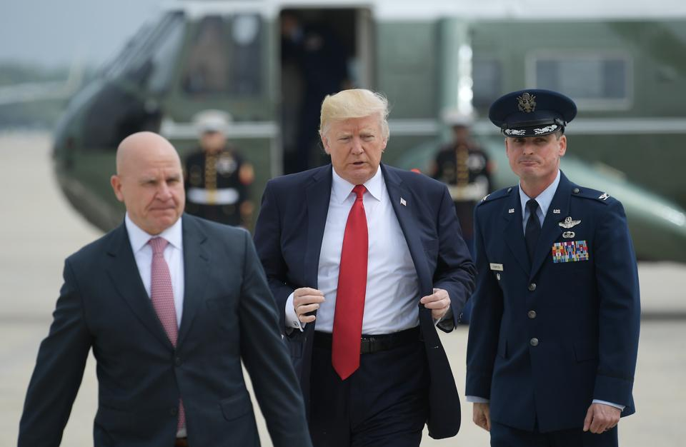 Donald Trump and national security advisor HR McMaster board Air Force One at Andrews Air Force Base.