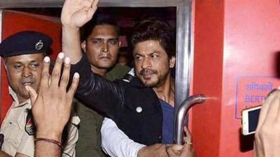 Shah Rukh Khan waves to the crowd before beginning his train journey from Mumbai to New Delhi.