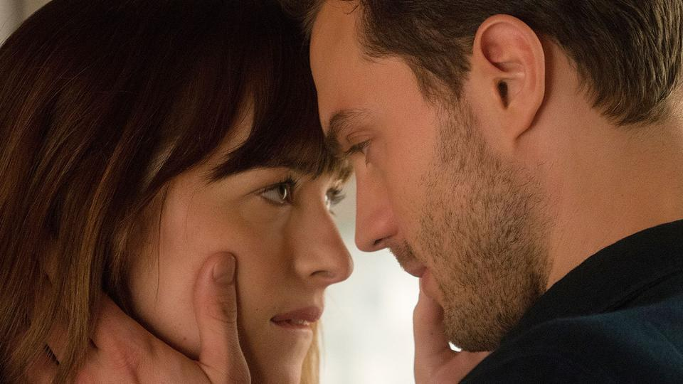 Dakota Johnson and Jamie Dornan in a still from Fifty Shades of Grey.