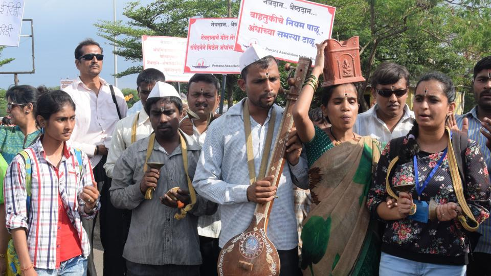 Visually challenged people from Prerna Association for the Blind join the walk. (ht photo )