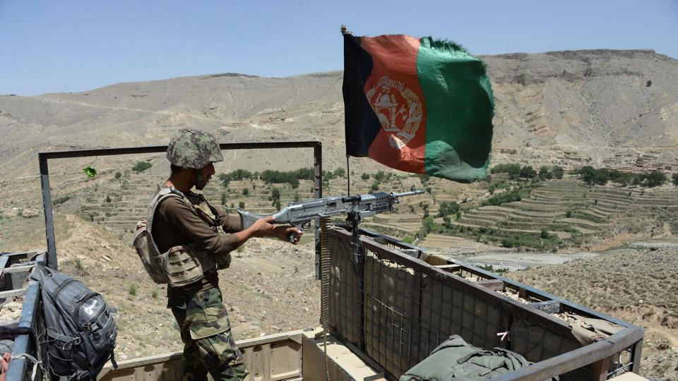 In this photograph taken on June 16, 2017 Afghan security force take positions during an operation against Islamic State (IS) militants in the Tora Bora village of Pachir Aw Agam district in Nangarhar province.