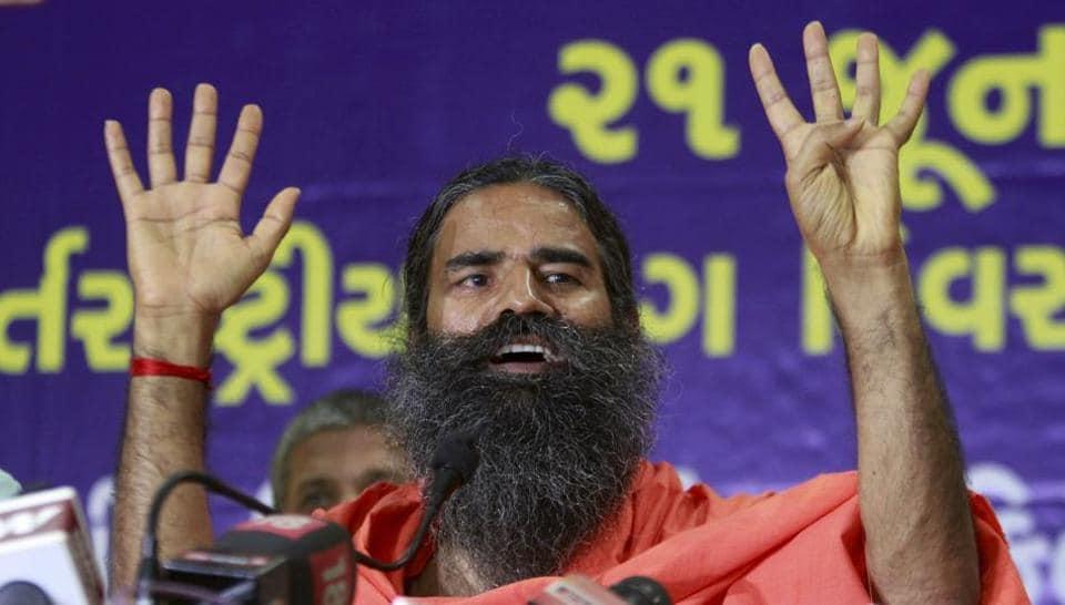 Yoga guru Baba Ramdev addresses a press conference ahead of International Yoga day in Ahmedabad.