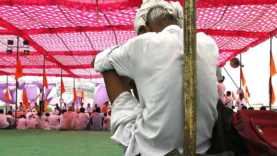 A farmer listens to a speech delivered at a sit-in protest by the Bharatiya Kisan Sangh last week.