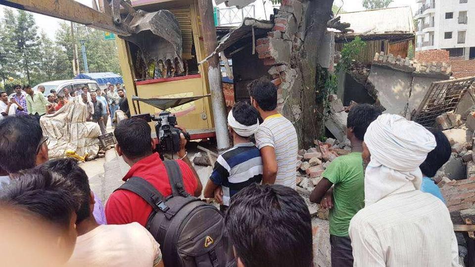 The MDDA team demolishes illegal structures at Transport Nagar in Dehradun on Saturday.