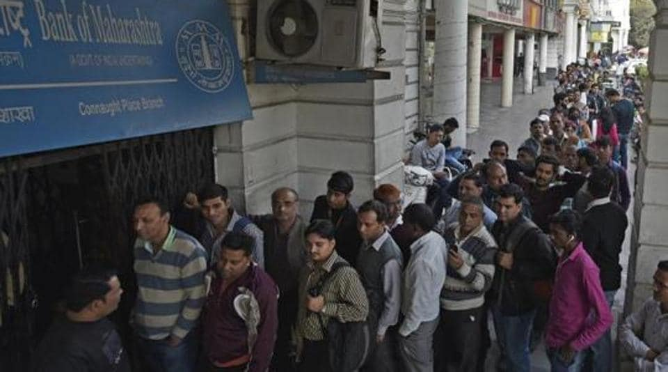 People standing in long queues to dispense currency at a working ATM in New Delh, in this file photo from December 12, 2016.