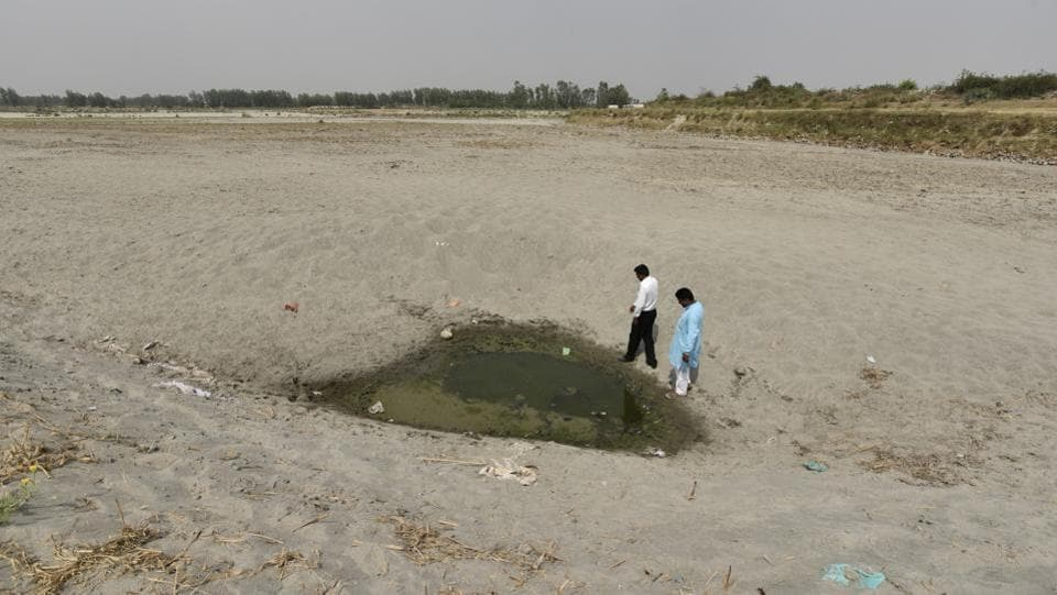 The Uttarakhand High Court in March declared the Ganga and Yamuna as living entities, bestowing on them same legal rights as a person. While mining, dams and hydro power projects extract life from the river, building  large Sewage Treatment Plant infrastructure has been the only solution that successive Yamuna Action Plans have  provided to revive the river. (Burhaan Kinu/HT PHOTO)