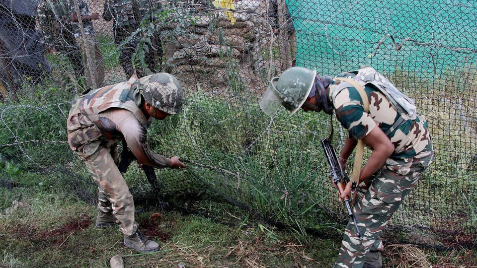 Security personnel carry out an inspection after a militant attack at Sumbal in Bandipora district of north Kashmir.