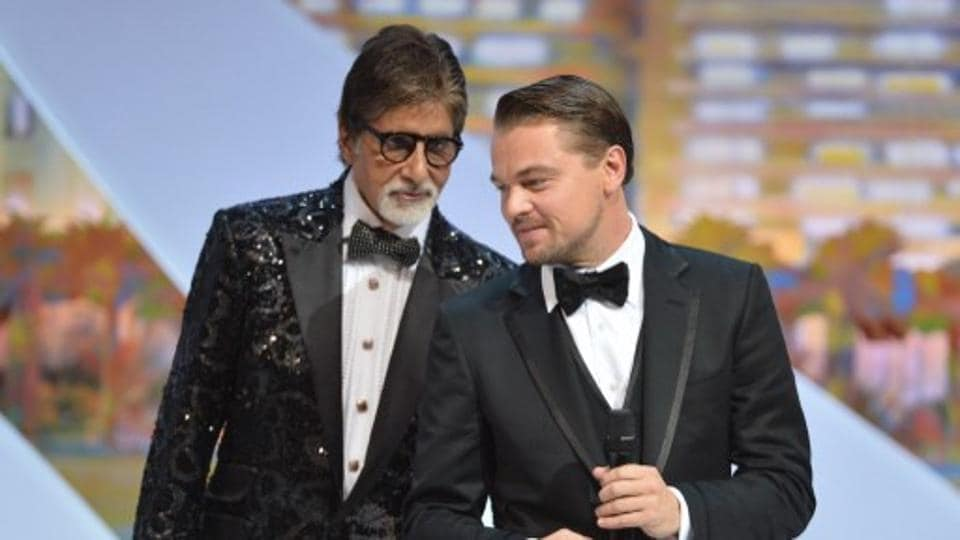 Leonardo DiCaprio (R) stands on stage on May 15, 2013 next to Amitabh Bachchan during the opening of the 66th edition of the Cannes Film Festival in Cannes.