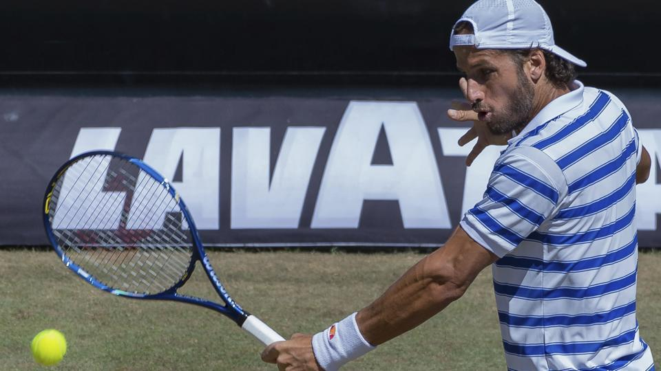 Spain's Feliciano Lopez returns to Czech Republic's Tomas Berdych during their quarterfinal match at the Stuttgart Open on Friday.