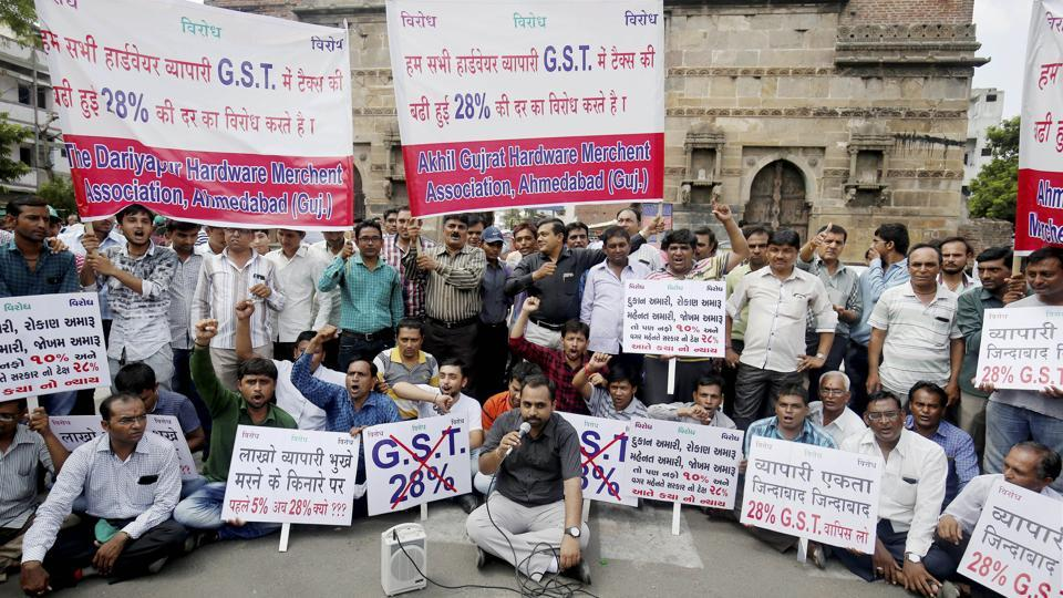 Hardware traders hold placards and shout slogans during a day-long protest against Goods and Services Tax (GST), in Ahmedabad, Gujarat on Friday.