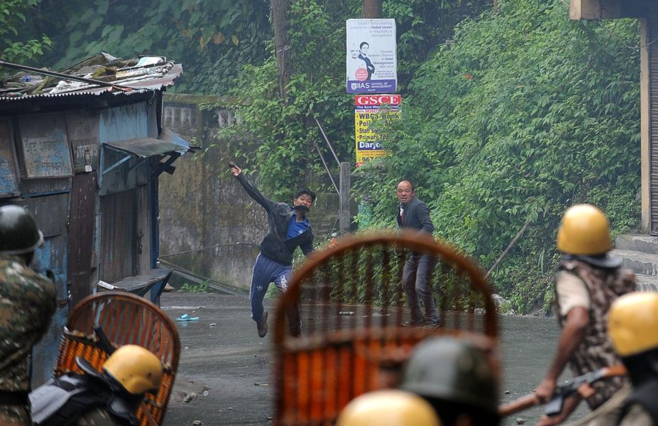 Supporter of the Gorkha Janmukti Morcha (GJM) clash with security forces in Darjeeling on Saturday.