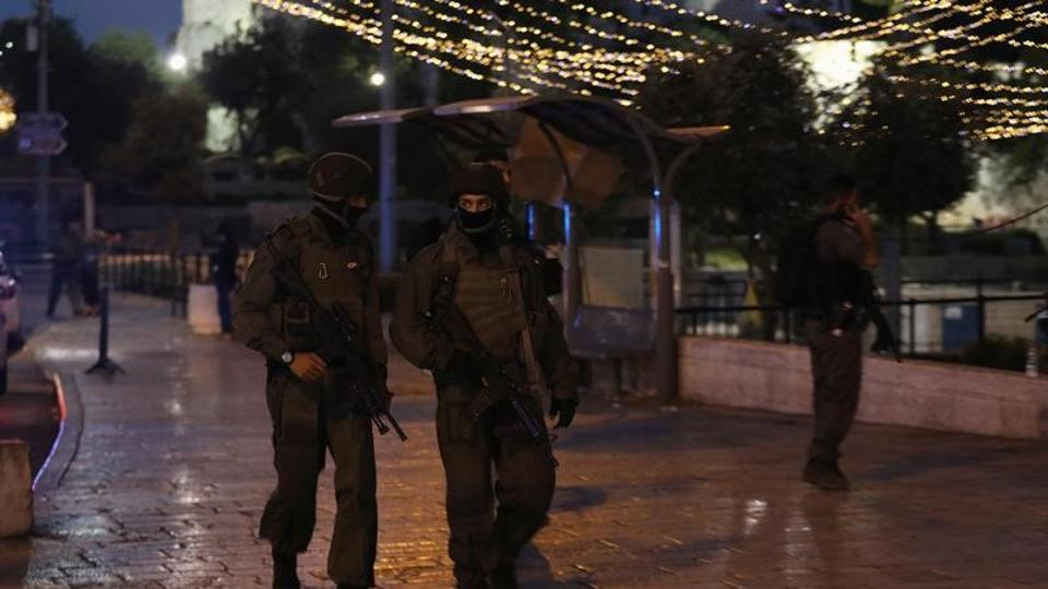 Israeli policemen secure the scene of the shooting and stabbing attack outside Damascus Gate in Jerusalem's Old City on June 16, 2017.