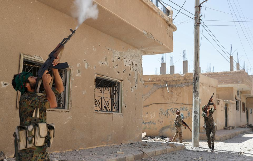 Kurdish fighters from the People's Protection Units (YPG) in Raqqa, Syria.