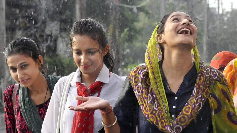 Enjoying the rain on Mall Road, Ludhiana, on Saturday, June 17. Maximum temperatures in most parts of Punjab and its neighbouring states hovered below normal levels, providing relief to the people from the heat conditions. Light rain made the day pleasant at several places. The forecast is of partly cloudy sky with possibility of rains or thundershowers during the next 48 hours. (Gurminder Singh/HT)