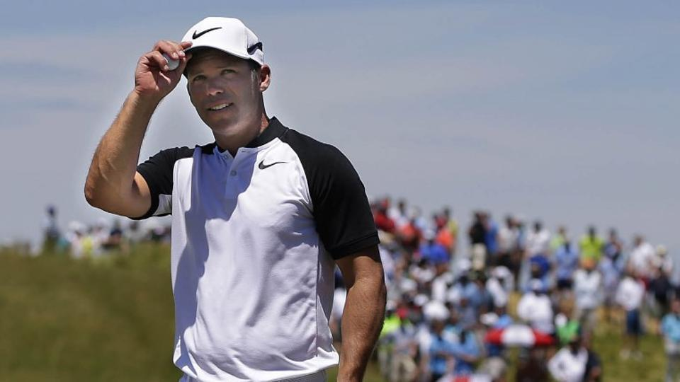 Paul Casey, joint leader of the USOpen golf tournament (alongside Brooks Koepka, Brian Harman and Tommy Fleetwood) greets the crowd after finishing on the 9th green during the second round at Erin Hills on Friday.