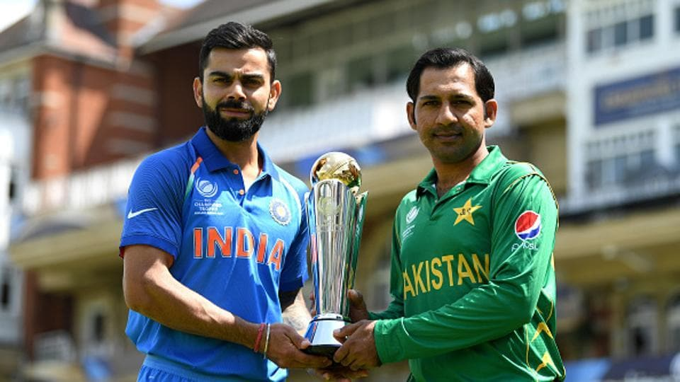 Virat Kohli and Sarfraz Ahmed pose with the ICC Champions Trophy ahead of India vs Pakistan final at The Oval on Sunday.  (Getty Images)